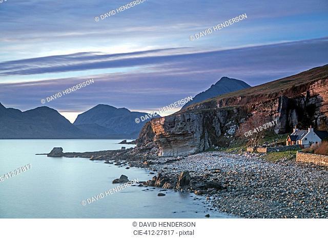 House on remote beach among cliffs, Elgol, Skye, Scotland