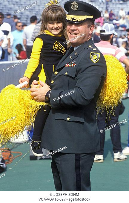 Military Officer with Little Girl at Football Game, West Point Military Academy, New York