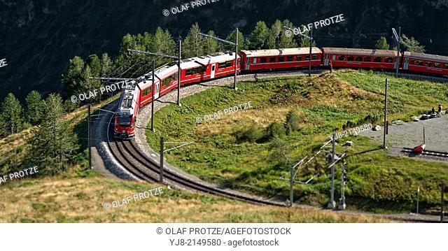 Bernina Express at Alp Gruem, with the Valposchiavo in the background, Engadin, Switzerland