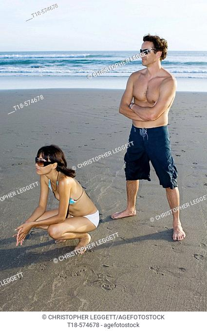 couple posing on beach