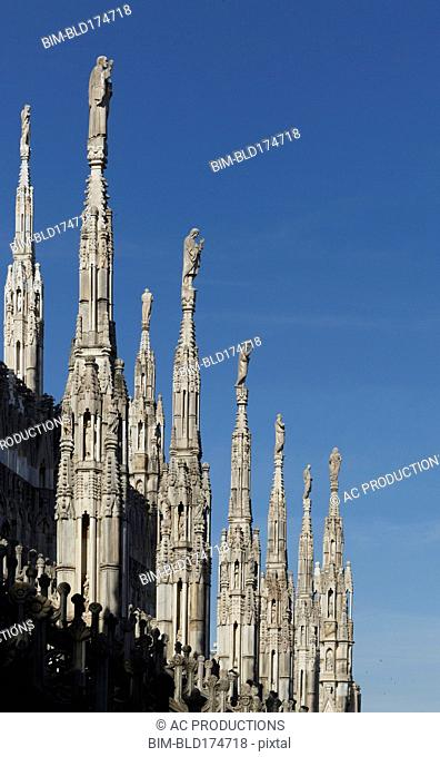 Low angle view of church spires, Milano, Lombardia, Italy