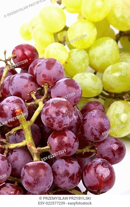 bunch of green and red grapes on a white background