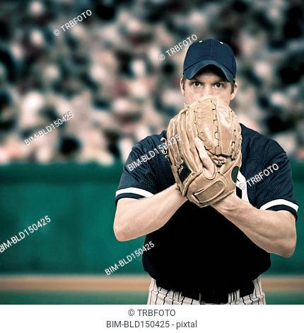 Caucasian baseball player holding glove