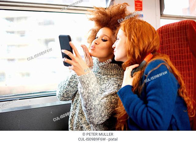 Friends on train, London