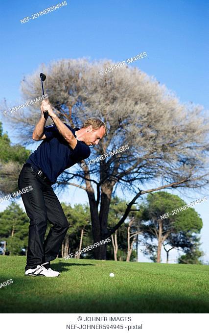 A Scandinavian man playing golf, Turkey