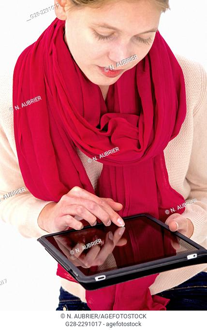 Young beautiful woman Holding a computer tablet and busy searching information