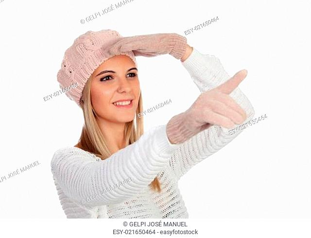 Attractive young caucasian woman in warm clothing pointing something