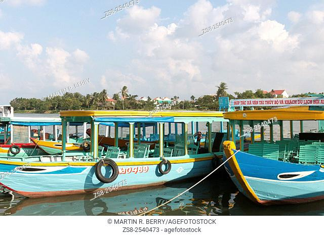 Timber boats in Hoi An for tourist trips on the river, Vietnam
