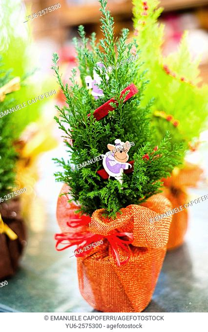 Christmas decorations for sale in a plant nursery, Lombardy, Italy