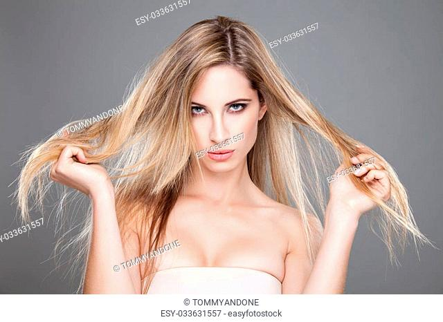 Beautiful woman with long and straight messy hair