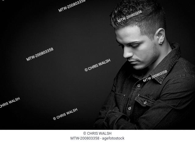 Black and white portrait teenage boy serious sad