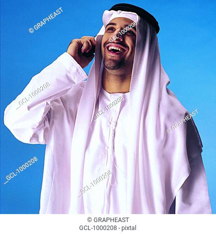 Arab man laughing on cell phone