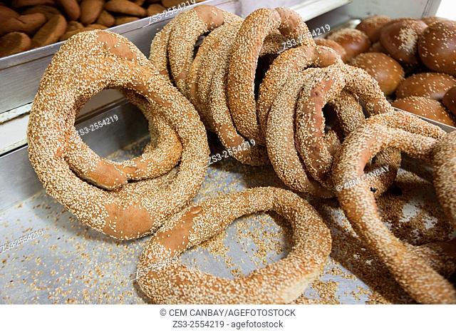 Fresh koulouri sesame bread rings on the tray in the bakery, Mykonos, Cyclades Islands, Greek Islands, Greece, Europe