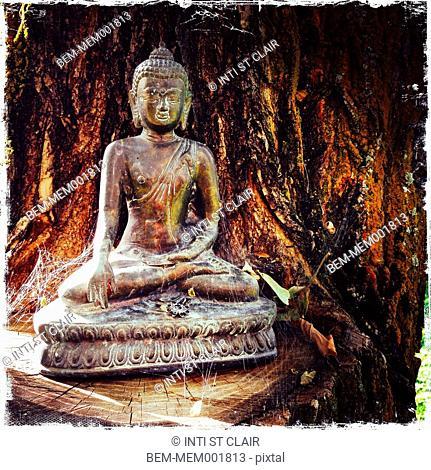 Cobwebs on dilapidated Buddha statue