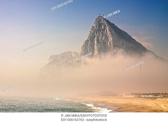 The Rock of Gibraltar, beautiful beach and Gibraltar rock in foggy morning