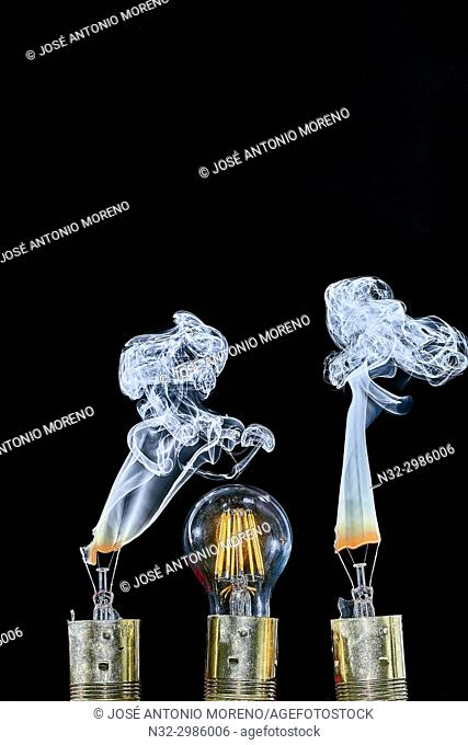 Bulb exploding with fire and smoke, Bulb, Broken lightbulb flares up in smoke, Benalmadena, Malaga Province, Andalusia , Spain