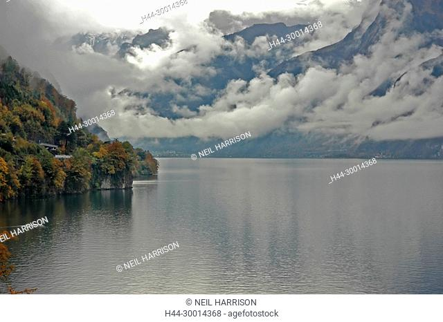 Lake surrounded by mountains in the fall with heavy clouds in an overcast sky. Lake Luzern in Switzerland