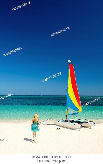 Woman on beach, Grace Bay, Providenciales, Turks and Caicos, Caribbean