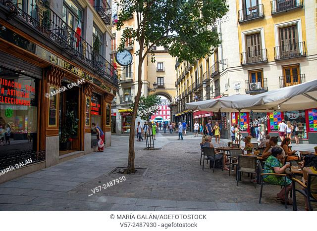 Terrace and traditional shops in Postas street. Madrid, Spain