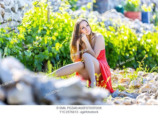 Young woman in vineyard in early morning light