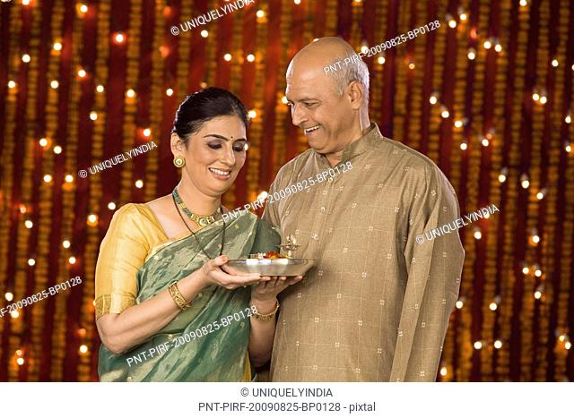 Couple standing with a pooja thali