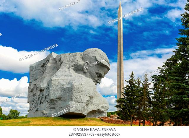 Main monument Brest Fortress - sculpture of Unknown soldier and hundred-meter bayonet obelisk at summer sunny morning, Belarus