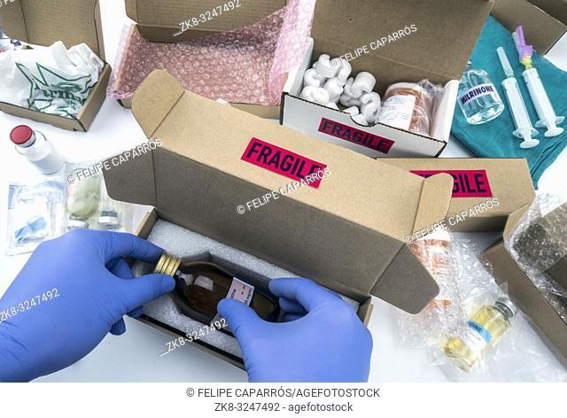 Nurse unpacking medication in boxes, conceptual image, horizontal composition