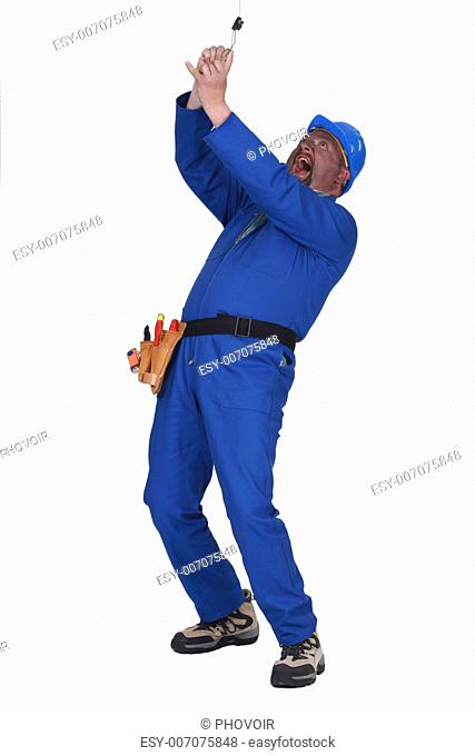 clumsy laborer getting electrocuted