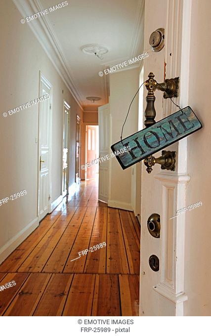 Home sign at door knob