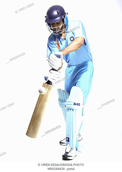 Indian batsman in action of playing ball in cricket match MR702A