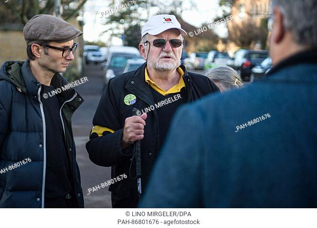 Dietrich Wagner (R) and Daniel Kartmann stand outside the State Ministry in Stuttgart, Germany, 27 December 2016. Kartmann underwent serious eye surgery for a...