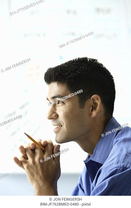 Profile of Asian businessman in front of whiteboard