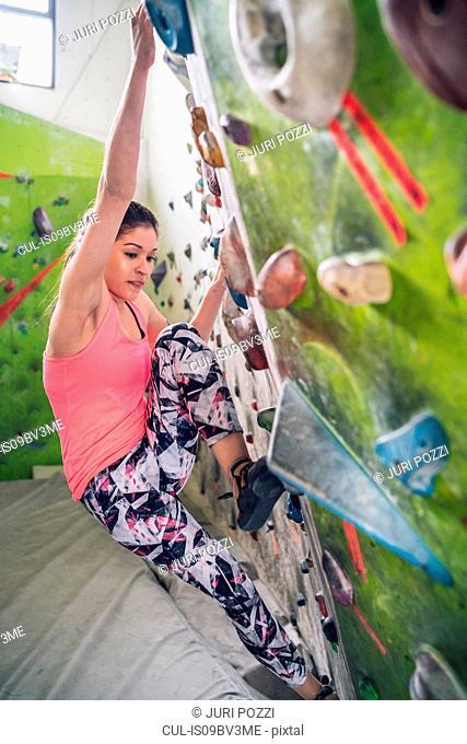 Climber on climbing wall