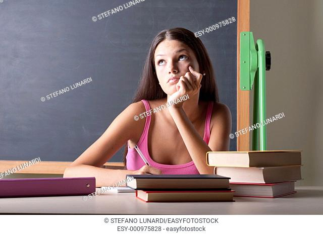 Pensive student at her desk