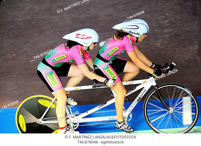 Visually impaired athlete riding tandem with a sighted guide, track cycling race