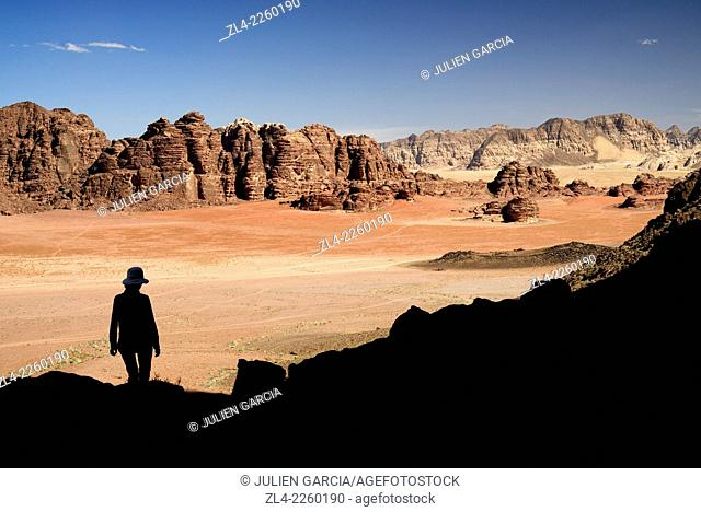 Silhouette of a woman and red sand desert from Jebel Qattar. Jordan, Wadi Rum desert, protected area inscribed on UNESCO World Heritage list