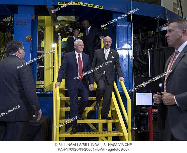 United States Vice President Mike Pence, left, and US Representative Robert Aderholt (Republican of Alabama) exit the Space Launch System (SLS) structural test...
