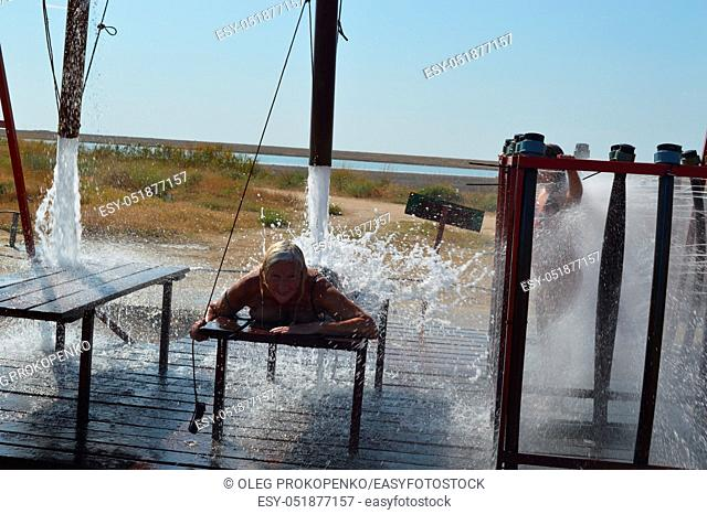 HENICHESK, UKRAINE - JULY 31, 2019: Reception of water procedures