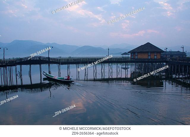 An early morning boater sets out from Garden Island Cottages at Inle Lake
