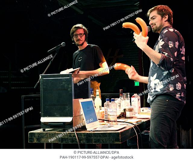 """10 January 2019, Berlin: While Lukas Diestel (l) reads from the book """"""""Worst of Chef"""""""", Jonathan Löffelbein shows meat sausages"""