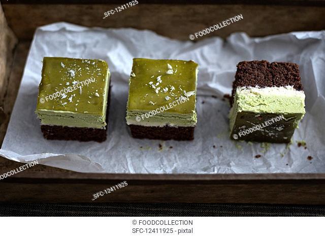 Vegan chocolate cake with tonka bean cream, matche cream and matcha jelly