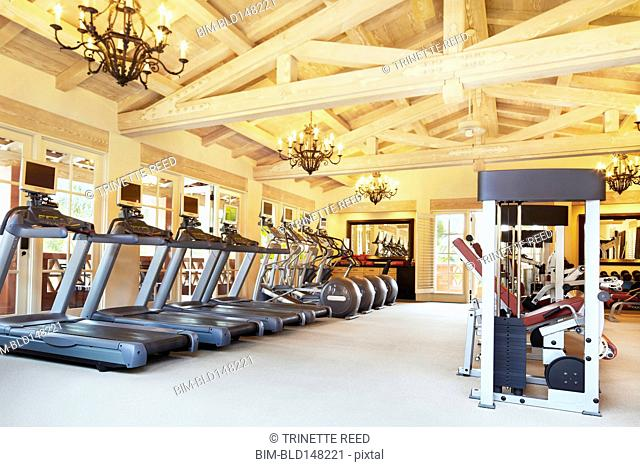 Treadmills and weight machines in health club