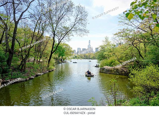 Tourist rowing boats on boating lake in Central Park, New York, USA