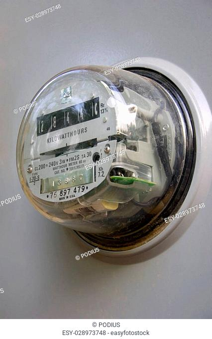an electrical meter in a gray box