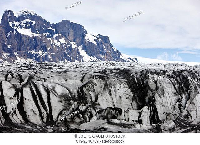 ash covered Skaftafell glacier end Vatnajokull national park in Iceland