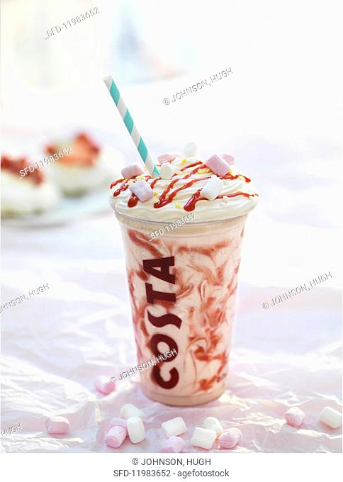 A creamy summer drink with strawberry sauce and marshmallows