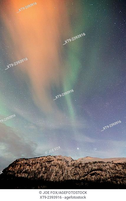 view of swirling northern lights and cloud aurora borealis near tromso in northern norway europe