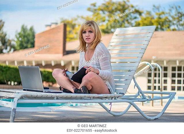 Attractive blond caucasian woman lounging