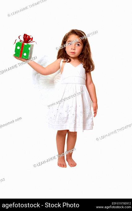 Little angel girl holding a present