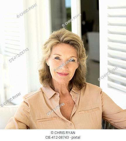 Portrait of smiling senior woman on patio